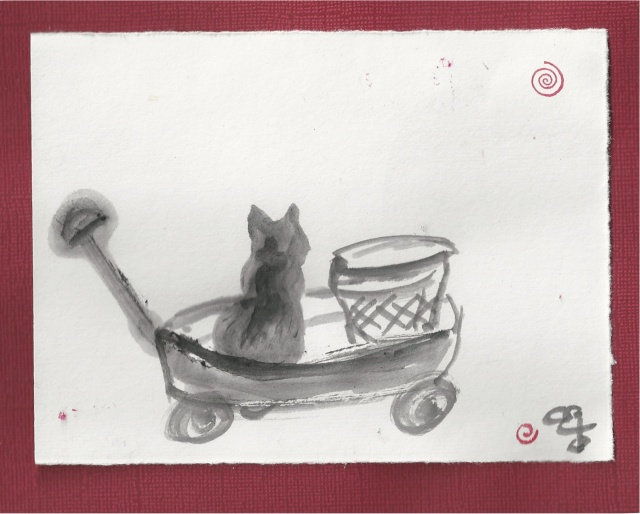 blk cat in garden cart