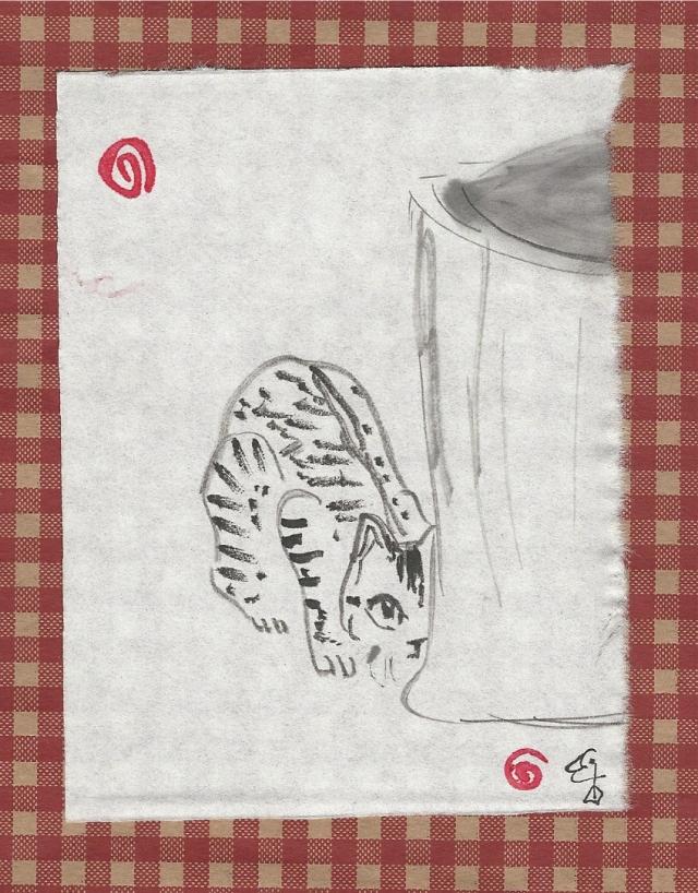 tabby-cat-crouching-behind-basket