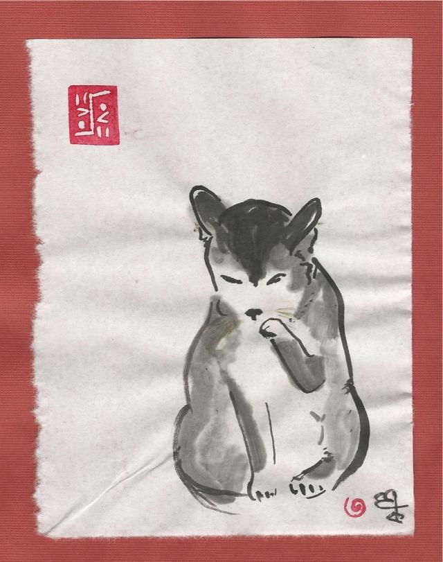 calico-cat-washing-paw